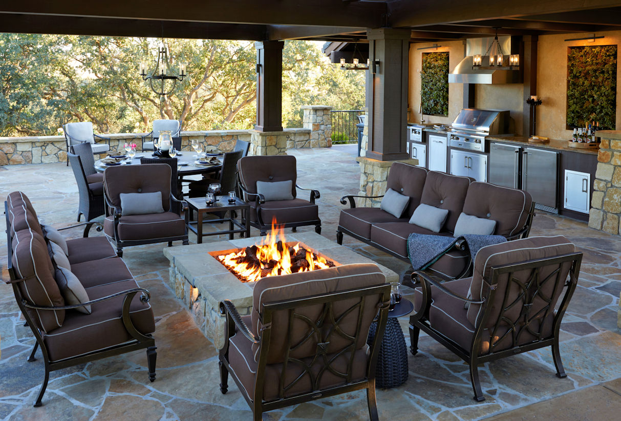 outdoor kitchen with custom fire table in Coastal Retreat Project by Tim Johnson at LIVIT
