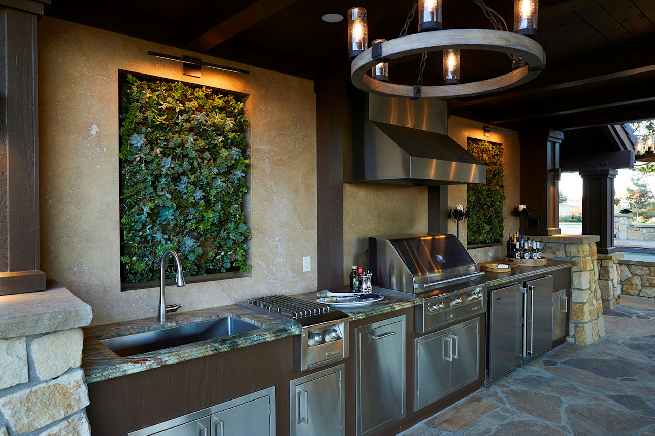 outdoor kitchen with vertical gardens in Coastal Retreat Project by Tim Johnson at LIVIT