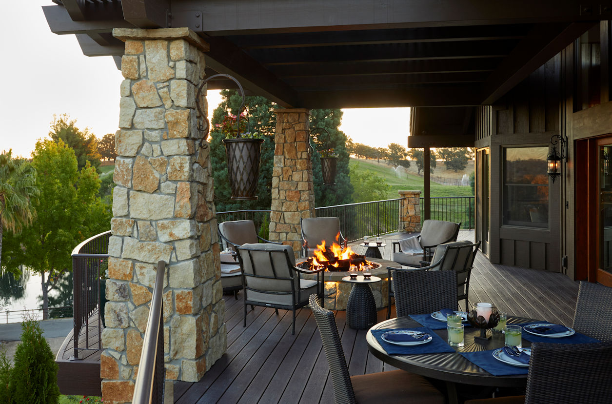 veranda with stone pillars in Coastal Retreat Project by Tim Johnson at LIVIT