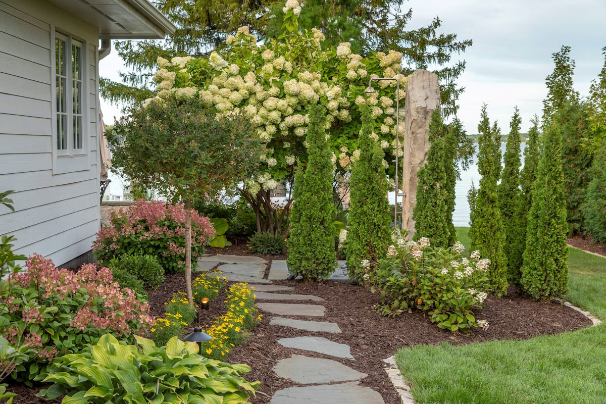 stepped path to outdoor shower in Beach House Beauty backyard landscape by Tim Johnson at LIVIT