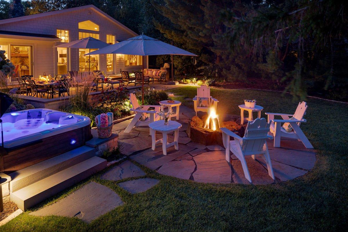 firepit and jacuzzi in Beach House Beauty backyard landscape by Tim Johnson at LIVIT